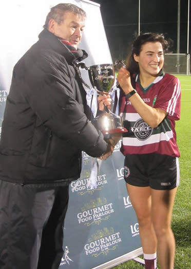 St Mary's ladies gaelic football team captain, Aine McAlister accepting the Gourmet Food Parlour Moynihan Cup